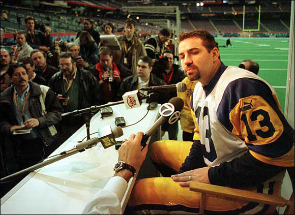 """To Rams QB Kurt Warner: """"Do you believe in voodoo, and can I have a lock of your hair?"""""""