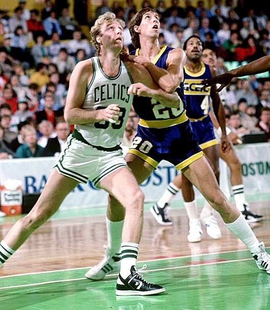 The former Wyoming star (shown here with Larry Bird) split four pedestrian seasons (5.5 points, 4.3 rebounds) between Dallas and Indiana.