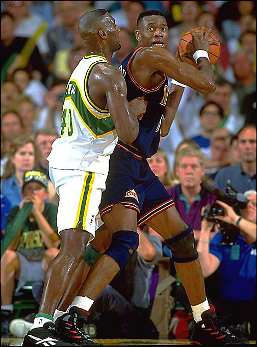 Though they barely finished over .500 (42-40), the Nuggets, fueled by Dikembe Mutombo (pictured), defeated top-seeded Seattle in overtime of Game 5 to win the series. It was the first time in history that an eighth seed defeated a No. 1. Seattle, led by Gary Payton and Shawn Kemp, was plagued by Mutombo, whose 31 blocks set a record for a five-game series.