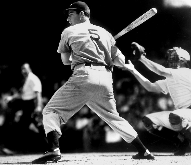 The 56-game hitting streak. A three-time MVP. Spouse of Marilyn Monroe. DiMaggio played his entire career (1936-1951) for the Yankees and hit .325 with 361 home runs.<br><br>Runner-up: Johnny Bench<br><br>Worthy of consideration: <br>Jeff Bagwell, Lou Boudreau, George Brett, <br>Nomar Garciaparra, Hank Greenberg, <br>Albert Pujols and Brooks Robinson