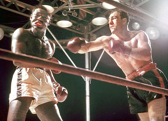 Rocky Marciano beats Ezzard Charles in 15 rounds to maintain the heavyweight title. The two fought again three months later with Marciano winning by KO in the eighth round.