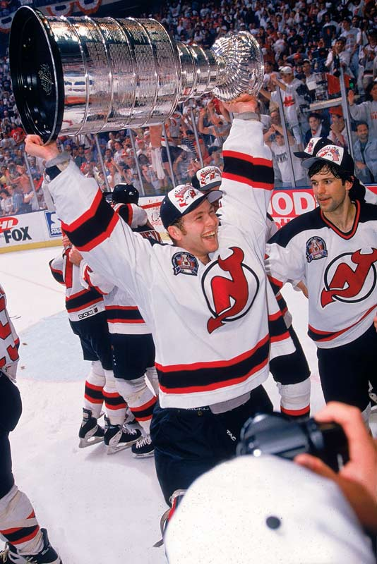 The New Jersey Devils sweep the Detroit Red Wings in four games to claim their first Stanley Cup.