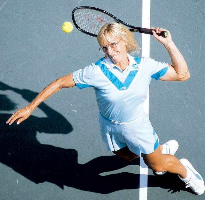 Martina Navratilova sets a Wimbledon record by participating in her 100th singles match.