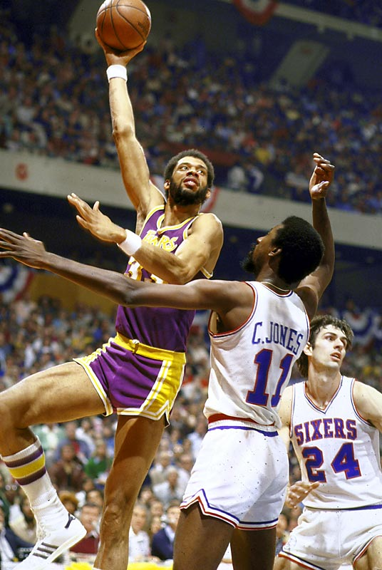 """Nobody did it better for longer. What's """"it?"""" Scoring, rebounding, defending and passing, all of which A-J was doing until he was 42 years old. His consistency is what earns him the start over the other great Lakers centers."""