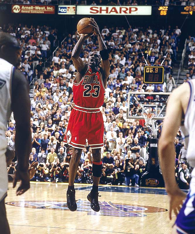 It was the perfect ending to Michael Jordan's career (at least we thought so at the time). With his team trailing by a point late in Game 6 of the '98 NBA Finals in Utah, Jordan stripped Karl Malone at one end, dribbled down court and swished a 20-footer with 5.2 seconds left to lift the Bulls to their second three-peat of the decade. Jordan, who was set to retire, held his pose for a moment as if to say farewell.