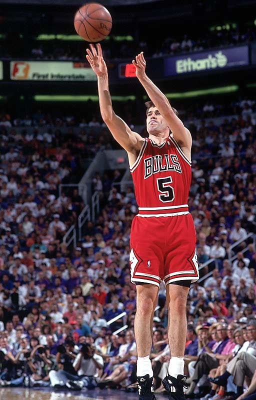John Paxson hit a lot of big shots for the Bulls, but none bigger than this one. With Chicago trailing late in Game 6 of the '93 Finals in Phoenix, Horace Grant got a pass from Scottie Pippen down low, turned and threw it back to Paxson open behind the three-point line. Johnny Jumpshot calmly drained it to give the Bulls a 4-2 series victory and the first of their two three-peats in the decade.