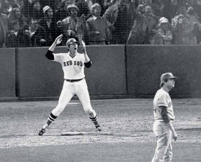 Carlton Fisk's famous home run ball, hit off the left field foul pole during the 1975 World Series, is sold for $113,273 at Leland's 'Hero's Auction' of sports memorabilia.