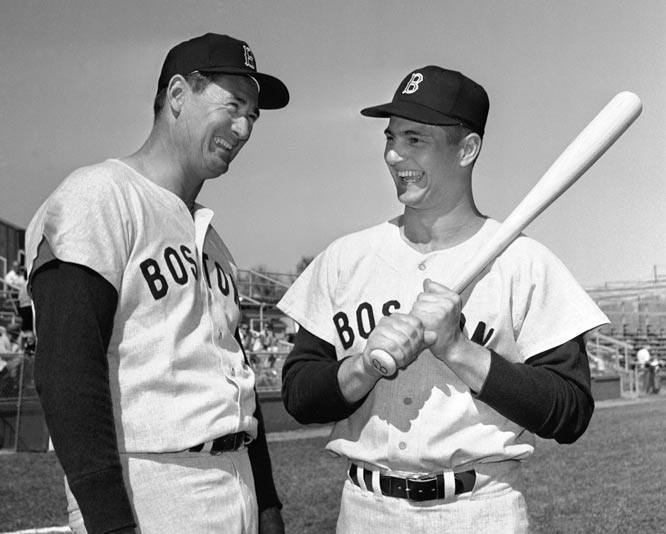 Carl Yastrzemski (pictured here in 1963 with Ted Williams) has his No. 8 jersey retired by the Red Sox.