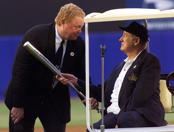 Rusty Staub (pictured here with Ted Williams) becomes only the second player to hit home run as a teenager and one after his 40th birthday. Ty Cobb was the first to accomplish the feat.