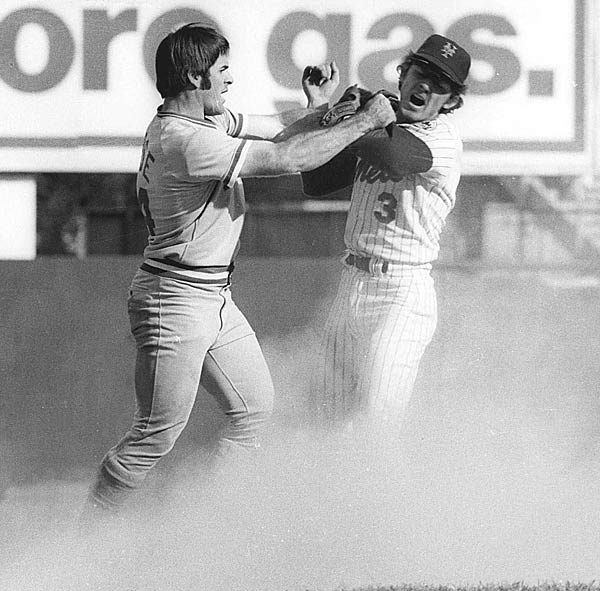 During Game 3 of the NLCS, a brawl breaks out between the Mets' Bud Harrelson and the Reds' Pete Rose.