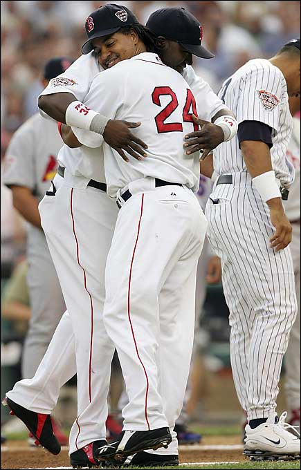 Common sight when he was with the Red Sox: cuddling with Papi.