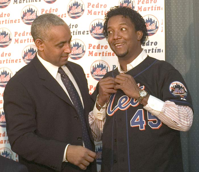 The Mets announce officially the club has come to terms with Pedro Martinez (16-9, 3.90 ERA) on a four-year, $53 million contract. The former Red Sox ace, who posted 117-37 record in seven seasons with Boston, criticizes his former team for not being more aggressive in retaining his services.