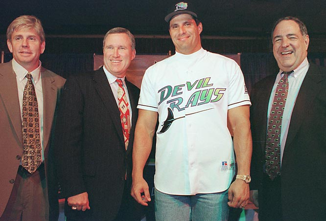 Tampa Bay signs Blue Jays free-agent Jose Canseco to a one-year deal to play left fielder and as a designated hitter.