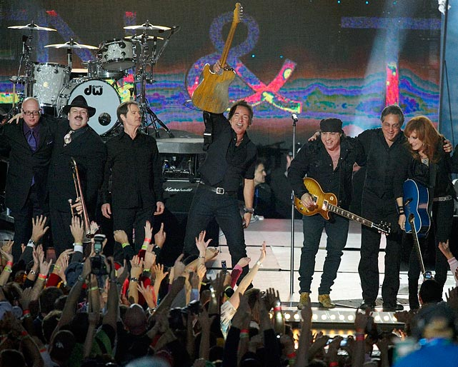 "The Boss brought plenty of energy to the halftime stage and worked seamlessly between older hits like ""Born to Run"" and ""Glory Days"" and newer ones like ""Working on a Dream."" The great showman even gave a powerful knee slide across the stage, crashing into a cameraman. A little too much rock and roll never hurt anyone though."