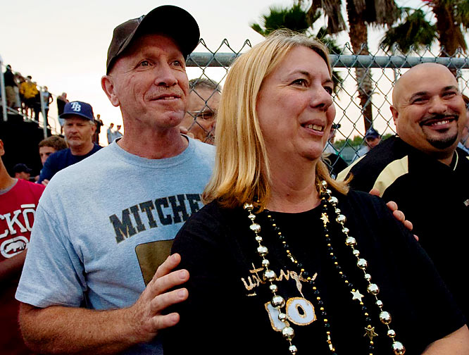 "Schuster's parents, Roger and Sharon, watched from the stands during Monday's game. The pitcher said of his mother: ""I've got the confidence, and she's over there biting her nails and stuff. I'm having fun with it and she's nervous. She's probably going to make me cry as soon as I see her."""
