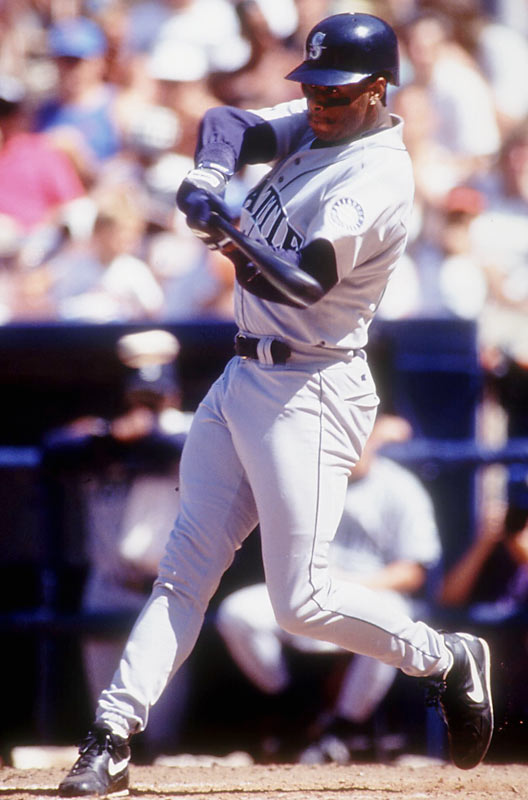 In his first major league at bat, Ken Griffey Jr. doubles off of Oakland's Dave Stewart.