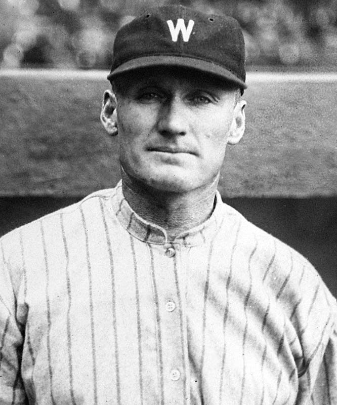 """Considered the greatest right-hander in baseball history, Walter Perry Johnson was a 10-time 20-game winner despite playing mostly for losing teams (he lost 27 games 1-0). With an overpowering fastball, """"The Big Train"""" led the American League in strikeouts 12 times and won three pitching triple crowns. His 110 career shutouts are 20 more than the second-best total."""