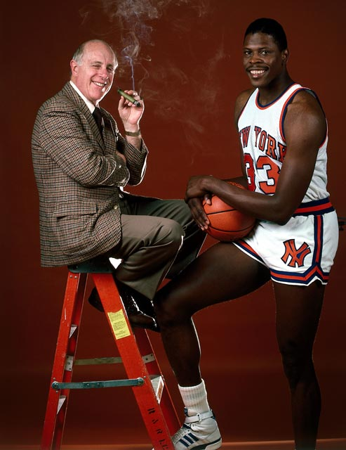 New York wins the first-ever NBA Draft Lottery, enabling the Knicks to select Georgetown center Patrick Ewing (pictured here with Red Auerbach) with the first pick in the 1985 NBA Draft.