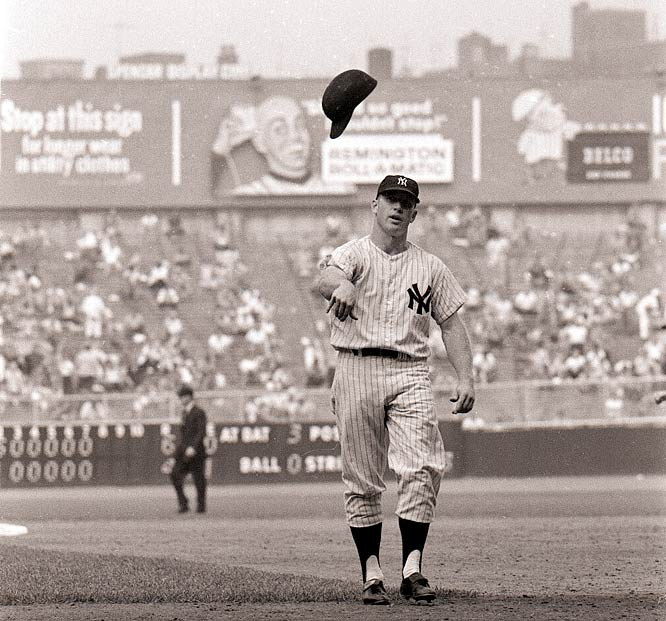 Mickey Mantle tosses his batting helmet toward the dugout after making the final out of an inning.