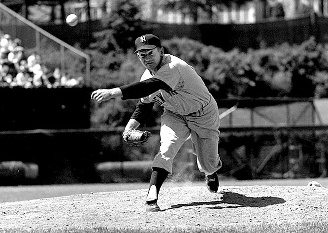 Whitey Ford unleashes a fastball during a game against the Orioles at Memorial Stadium.