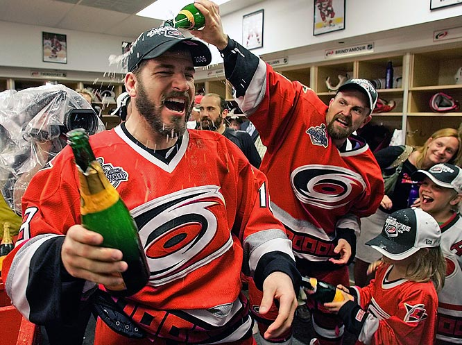 Cory Stillman pours champagne on teammate Mark Recchi as the team celebrates in their locker room after defeating  the Edmonton Oilers 3-1 in Game 7 of the Stanley Cup hockey finals.