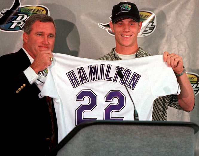 Outfielder, Athens Drive High<br><br>Hamilton's well-documented journey to stardom is one of the most fascinating stories in the game today. The Rays took the high school phenom over Josh Beckett, who went second in the '99 draft. He was regarded as one of baseball's top prospects until a car accident prior to the 2001 season. After the accident, Hamilton started on a downward spiral into drug addiction. He was suspended for violating the MLB's drug policy and did not play baseball from 2004 to '06, going in and out of rehab attempts. The Reds scooped him up through the Rule 5 Draft in 2006. In 2007, he hit .292 with 19 homers and 47 RBIs in 90 games, but Cincinnati traded him to Texas for Edinson Volquez. Hamilton fully realized his immense potential in 2008, hitting .304 with 32 homers and 130 RBIs and playing in his first All-Star Game (putting on an unforgettable show during the Home Run Derby).