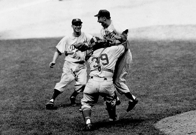 After losing to the hated Yankees in 1947, 1949, 1952 and 1953, Dem Bums finally did it in 1955, vanquishing their rivals in seven games. Brooklyn won a taut Game 7 (and the franchise's first World Series title) behind the clutch pitching of Johnny Podres, who never again had to buy a drink in Brooklyn.