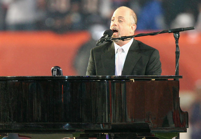 Billy Joel becomes the first rock artist to perform at Yankee Stadium.