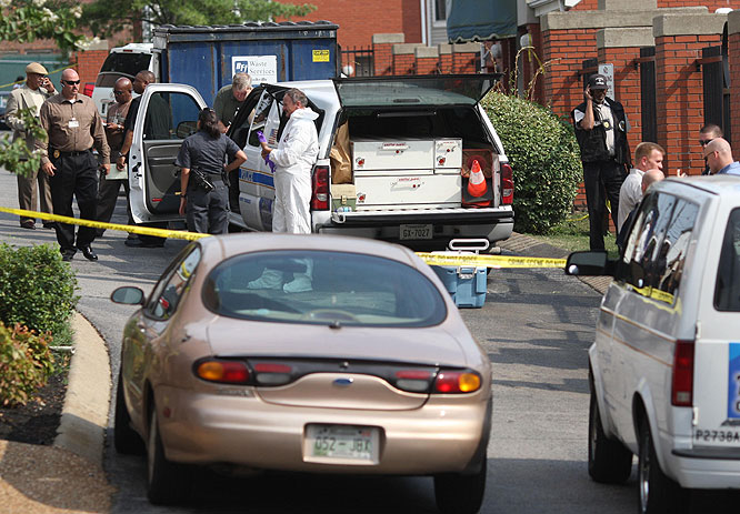 Nashville, Tenn., police gather outside of an apartment where the body of Steve McNair was found on Saturday, July 4, 2009.