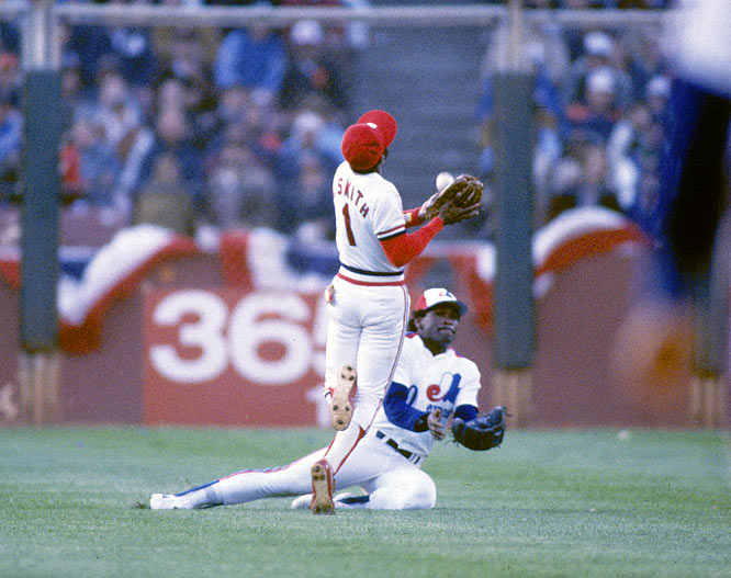 Ozzie Smith nearly collides with Andre Dawson as the two track down a pop-up in the third inning.