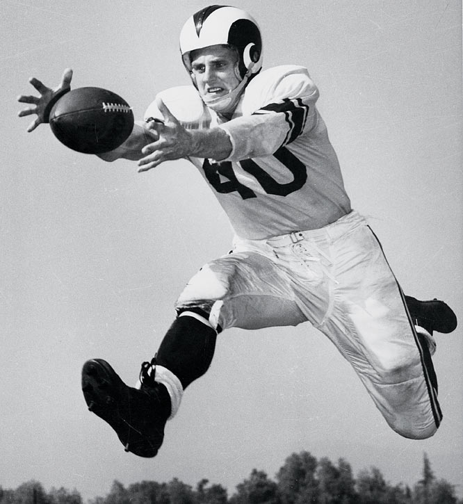 """Wrote Francis Powers of the Chicago Daily News: """"Hirsch ran like a demented duck. His crazy legs were gyrating in six different directions all at the same time during a 61-yard touchdown run that solidified the win."""" From then on, the back and big-play receiver was Crazy Legs. As a member of the 1951 champion St. Louis Rams, Hirsch caught for 17 touchdowns and a then NFL-record 1,495 yards."""