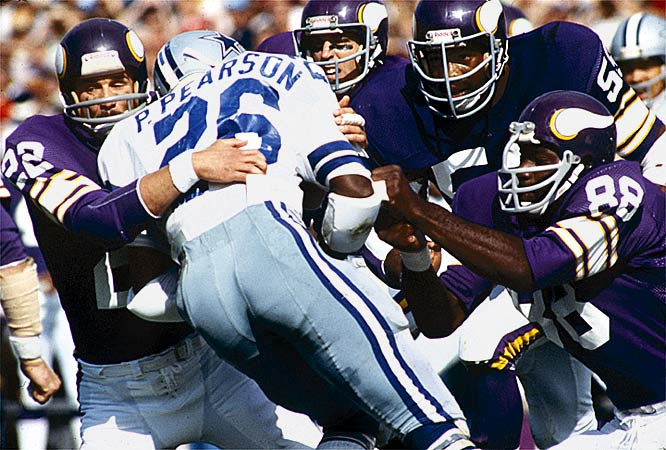 """Stemming from their purple uniforms and the popular song by Sheb Wooley of the same name, the Purple People Eaters were one of most fearsome front fours of the late 1960s and 70s. Powered by Hall of Fame defensive end Carl Eller and defensive tackle Alan Page, and playing by the motto """"meet at the quarterback,"""" the People Eaters powered the Vikings to four Super Bowl trips in the 70s."""