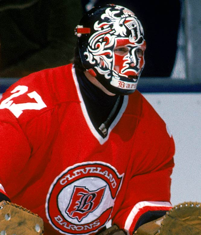 "Meloche's ""heraldry"" mask was designed by Harrison, who created his own Cleveland crest for Meloche after the California Golden Seals moved to Ohio to become the Barons in 1976."