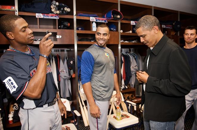 Tigers centerfielder Curtis Granderson snaps a keepsake while Nelson Cruz looks on.