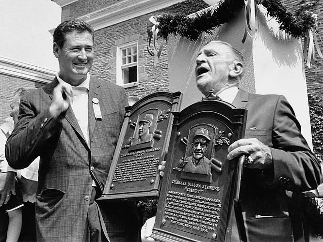 Ted Williams, Casey Stengel. <br><br>Williams wasn't the greatest hitter who ever lived (Ruth was), but he might have been the second best. Along the way, he flew combat missions in two wars, and when he was inducted into the Hall by the press corps he had feuded with throughout his career, he used the occasion to lobby for the inclusion of Negro Leaguers. Stengel was the most successful manager in major league history, winning 10 pennants and seven World Series in a dozen years with the Yankees. He was also one of the game's great characters and the thread that connects the great Orioles teams of the 1890s (via John McGraw) with today's game (via Billy Martin and Lou Piniella).