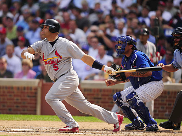 At Wrigley Field, Albert Pujols goes 5-for-5, including three home runs and five RBIs, as the Cardinals beat the Cubs, 11-8. The first baseman's first three-homer career game helps St. Louis to erase a six run deficit.