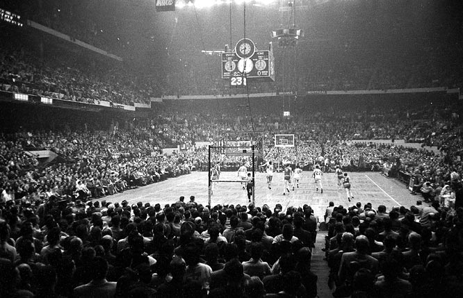 Memories of less clutter: The Celtics and St. Louis Hawks tangle at the old Boston Garden in 1957.