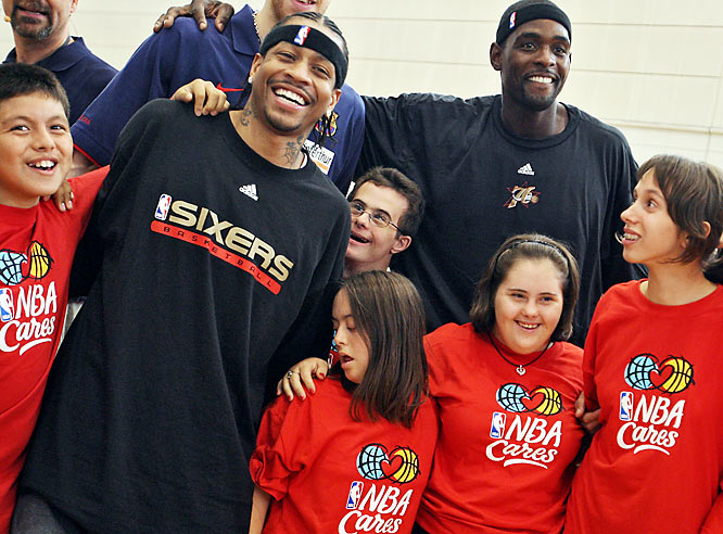 Allen Iverson and Chris Webber pose with children during a Special Olympics Clinic in Barcelona.