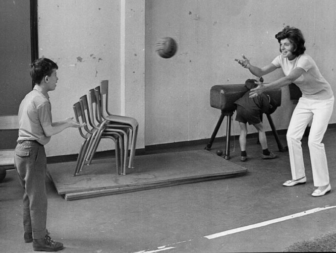 Kennedy Shriver plays handball with a mentally handicapped student in Paris.