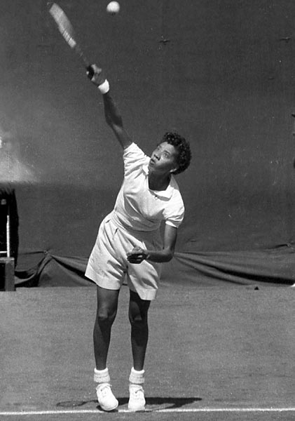 Althea Gibson serves during the 1956 Open at the West Side Tennis Club in Forest Hills. Gibson won two Opens in singles (1957, '58) and one in doubles (1957).