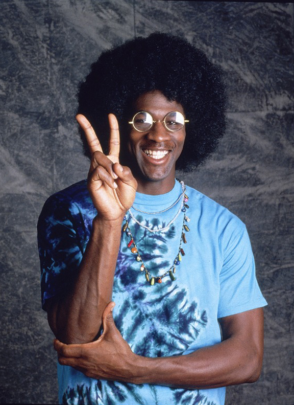 """<p>Jordan in this hippie disguise is also from the May 1992 issue.MJ didn't know he'd be dressing up that day,and he laughed when he arrived at the shoot and saw the photographer, George B. Fry III, wearing this afro wig. """"We were in hysterics a lot of the time,"""" says Fry.</p>"""