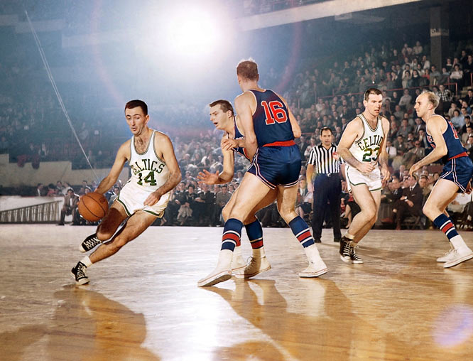 Bob Cousy (pictured), Bob Pettit, Abe Saperstein.<br><br>Any countdown of the top 10 induction classes in the 51-year history of the Naismith Memorial Basketball Hall of Fame that can start with the 1971 group is a tribute to all those groups that didn't make our cut. Pettit was a pioneer for all big men who prefer to face the basket and step out for 18-footers. Saperstein was the consummate marketer, turning the Harlem Globetrotters into a hoops <i>and</i> entertainment sensation. Come to think of it, that describes Cousy and his ball-handling success.