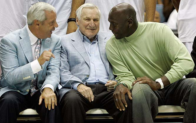 Current North Carolina coach Roy Williams confers with Dean Smith and Michael Jordan.