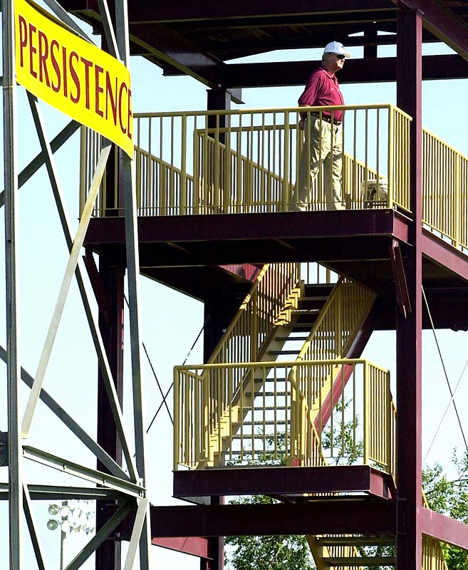 Bobby Bowden gets a bird's eye view of the action as he paces atop his garnet and gold tower in the center of FSU's practice field.