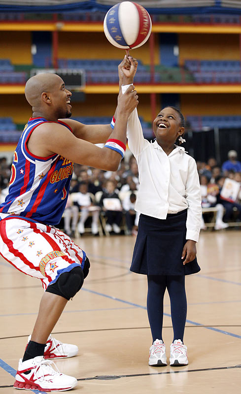 Scooter Christiansen works on spin control with nine-year-old Racine McEachin of Harlem's P.S. 36.
