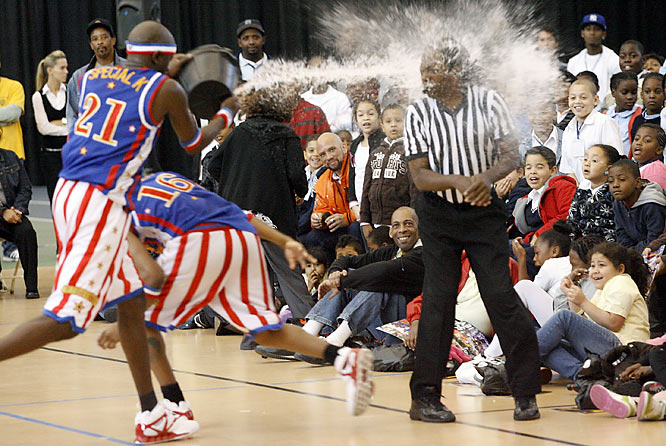 Some tricks never get old -- especially for an audience of nine- and 10-year olds. Referee Eric Weaver is all wet, thanks to Special K.