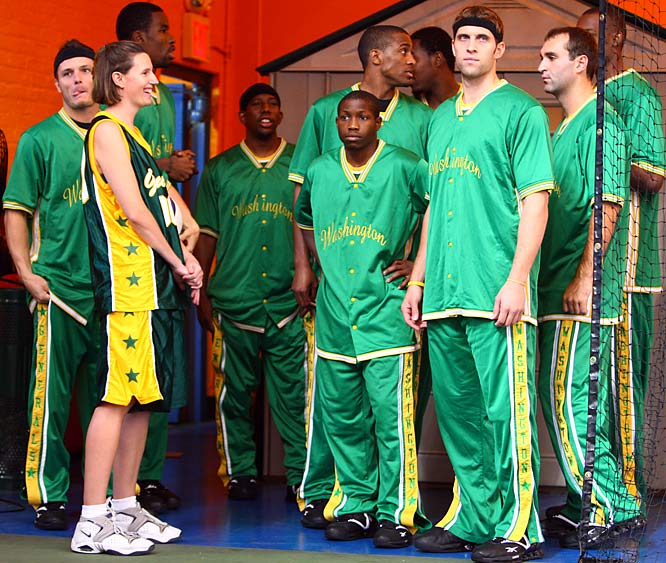 Sports Illustrated editor Trisha Blackmar was invited to participate in the game as a member of Washington Generals, the Globetrotters' archrivals. Here she waits to take the court with her teammates before the game.