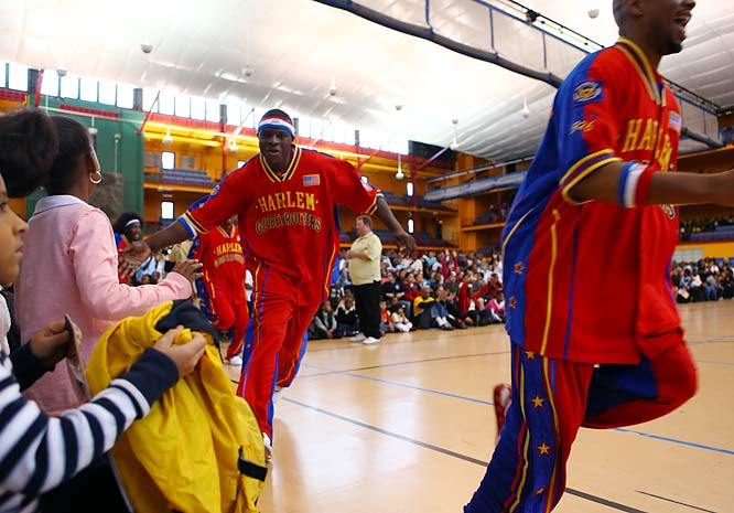 "To the strains of ""Sweet Georgia Brown,"" the Globetrotters entered with much fanfare."