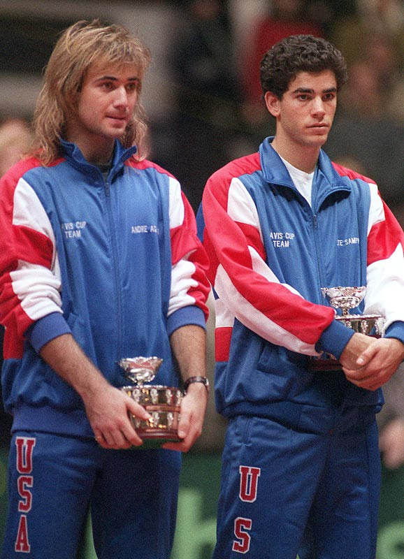 Andre Agassi and Pete Sampras hold their trophies, but can't hide their disappointment after losing to France in the Davis Cup finals.