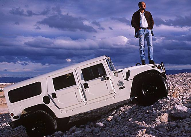 Andre Agassi enjoys the view from the roof of his Humvee.